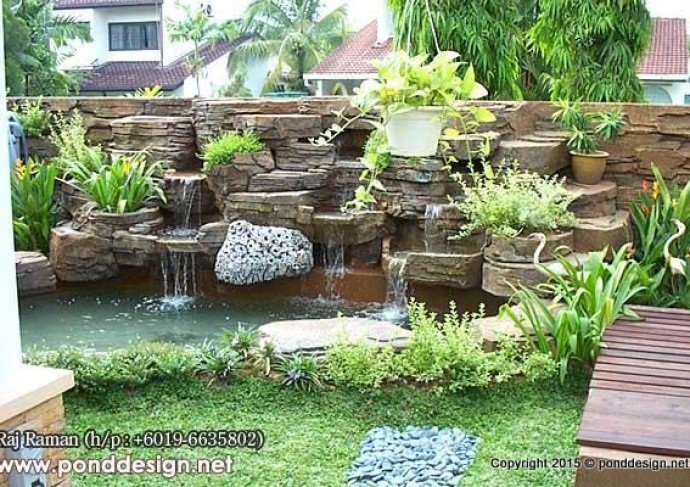 Artificial waterfall made of stone for fish pond for Concrete koi pond design